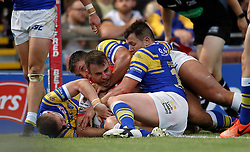 St Helens' Ryan Morgan goes over for a try against Leeds Rhinos during the Betfred Super League match at Headingley Stadium, Leeds.