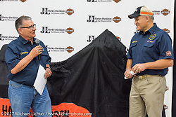 USS South Dakota commissioning committee member Lieutenant Tom Muenster (L), USN Ret of Sioux Falls and Jim Entenman at Jim's J and L Harley-Davidson just before the unveiling of a 2018 Harley-Davidson Street Glide donated by the Motor Company and painted by J and L to commemorate the christening of the USS South Dakota submarine. Sioux Falls, SD. USA. Monday October 9, 2017. Photography ©2017 Michael Lichter.
