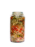 A jar of preserved vegetables prepared for the winter by a peasant farmer, Botiza, Maramures, Romania
