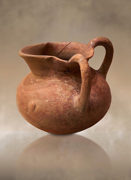 Hittite terra cotta two handled pitcher. Hittite Period, 1600 - 1200 BC.  Hattusa Boğazkale. Çorum Archaeological Museum, Corum, Turkey. Against a warm art bacground. .<br />  <br /> If you prefer to buy from our ALAMY STOCK LIBRARY page at https://www.alamy.com/portfolio/paul-williams-funkystock/hittite-art-antiquities.html  - Type Hattusa into the LOWER SEARCH WITHIN GALLERY box. Refine search by adding background colour, place,etc<br /> <br /> Visit our HITTITE PHOTO COLLECTIONS for more photos to download or buy as wall art prints https://funkystock.photoshelter.com/gallery-collection/The-Hittites-Art-Artefacts-Antiquities-Historic-Sites-Pictures-Images-of/C0000NUBSMhSc3Oo