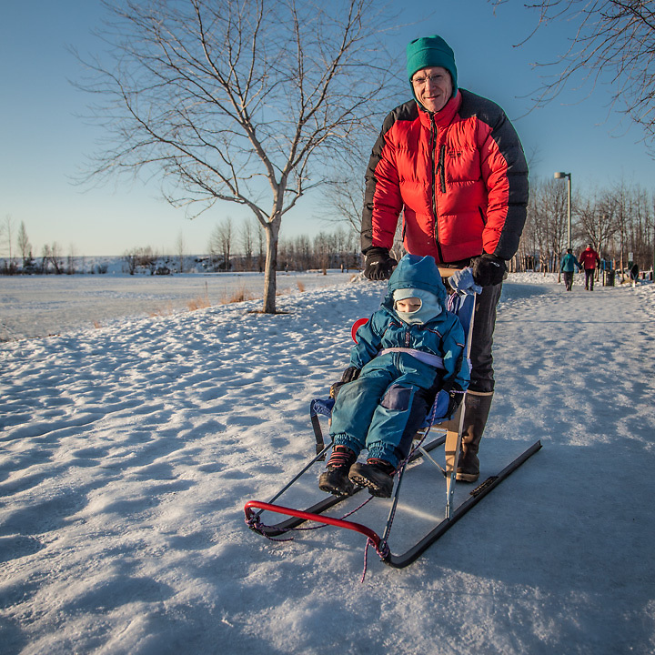 """""""We went out for a walk and Talvin fell asleep.""""  """"Anchorage is great for a guy like me…lot's to do out of doors.""""  """"My son, Talven, really does like to kicksled, but you might not think so from the photo!""""  -David Wigglesworth with his seven year old son at Westchester Lagoon, Anchorage"""