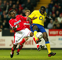 Photo. Chris Ratcliffe<br />Charlton v Arsenal. FA Premiership. 26/10/2003<br />kolo Toure just nicks the ball away from Jason Euell in the 1-1 draw at the Valley