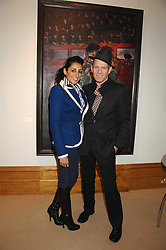 SERENA REES and PAUL SIMONON at a private view of his recent paintings held at Thomas Williams Fine Art, 22 Old Bond Street, London on 15th April 2008.<br />