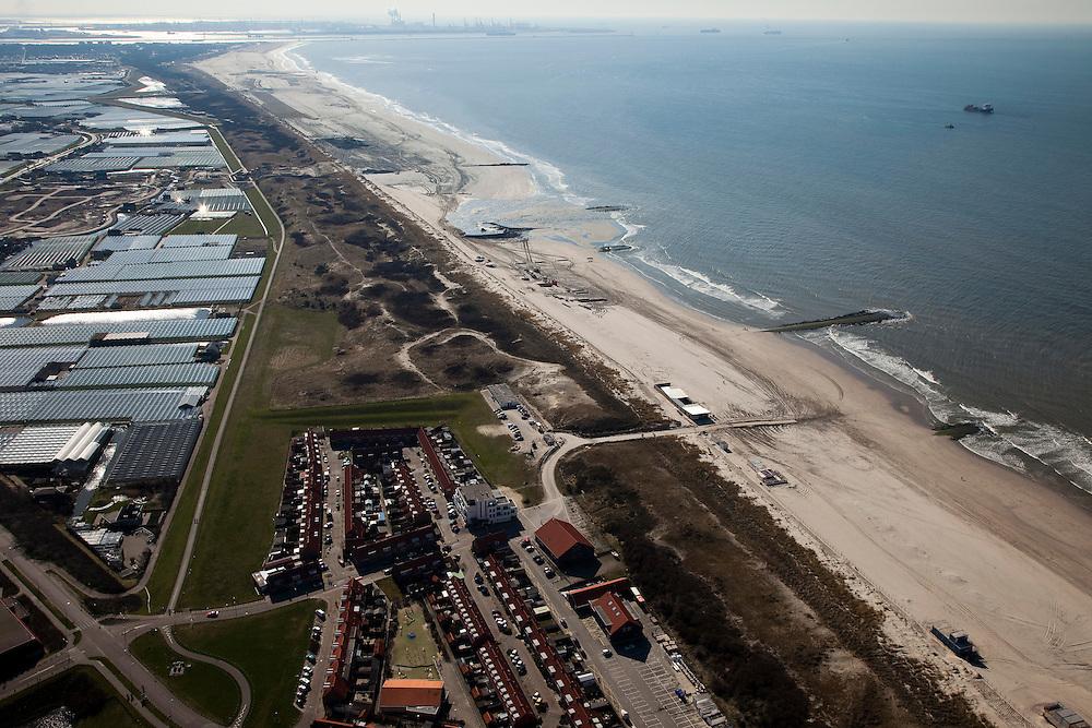 """Nederland, Zuid-Holland, Monster, 18-03-2009; Versterking van de kust van Delfland tussen Ter Heijde en Hoek van Holland. De kust bij Ter Heijde, onder in beeld, is een van 'Zwakke Schakels' in de zeewering door de geringe breedte van de duinen. Links van de duinen de Slaperdijk. Richting Hoek van Holland is het strand extra verbreed om een nieuwe duinenrij met duinvallei te maken, natuurcompensatie in verband met de aanleg van de Tweede Maasvlakte. Links achter de duinen de kassen van het Westland, Maasvlakte aan de horizon..Strengthening of the coast of Delfland between Hoek van Holland and Ter Heijde by means of sand-supplementation. This coast is known as one of the """"weak links""""  because of the small width of the dunes. In the direction of Hoek van Holland, extra sand has been applied to make an extra dune valley on the beach. This so-called nature compensation is necessary because of the construction of the nearby Maasvlakte 2. To the left and behind the dunes the greenhouses of the Westland area, the Maasvlakte (land reclamation for Port of Rotterdam) at the horizon..Swart collectie, luchtfoto (toeslag); Swart Collection, aerial photo (additional fee required); .foto Siebe Swart / photo Siebe Swart"""