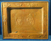 Terra sigillata tray and a fragment from a similar vessel.  The finest pottery, Late Roman period, was made of a fine-grained red slip ware, known as terra sigillata, This tableware is decorated by stamping.  The large tray has a depiction of St Peter and St Paul enthroned, Jonah and the whale and fishes, symbolising Christ on the rim.  Restored. North African workshop, late 4th century.