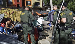January 29, 2018 - Anaheim, California, USA - Orange County Sheriff deputies chat with a man in the homeless encampment along the Santa Ana River in Anaheim on Monday, Jan 29, 2018. (Credit Image: © Jeff Gritchen/The Orange County Register via ZUMA Wire)
