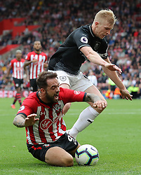 Southampton's Danny Ings (left) goes to ground under pressure from Burnley's Ben Mee during the Premier League match at St Mary's, Southampton.