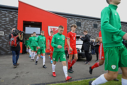 WREXHAM, WALES - Wednesday, October 30, 2019: Republic of Ireland's Corey McLoughlin (L) and Wales' Here Hewitt-White walk out before the 2019 Victory Shield match between Wales and Republic of Ireland at Colliers Park. (Pic by David Rawcliffe/Propaganda)