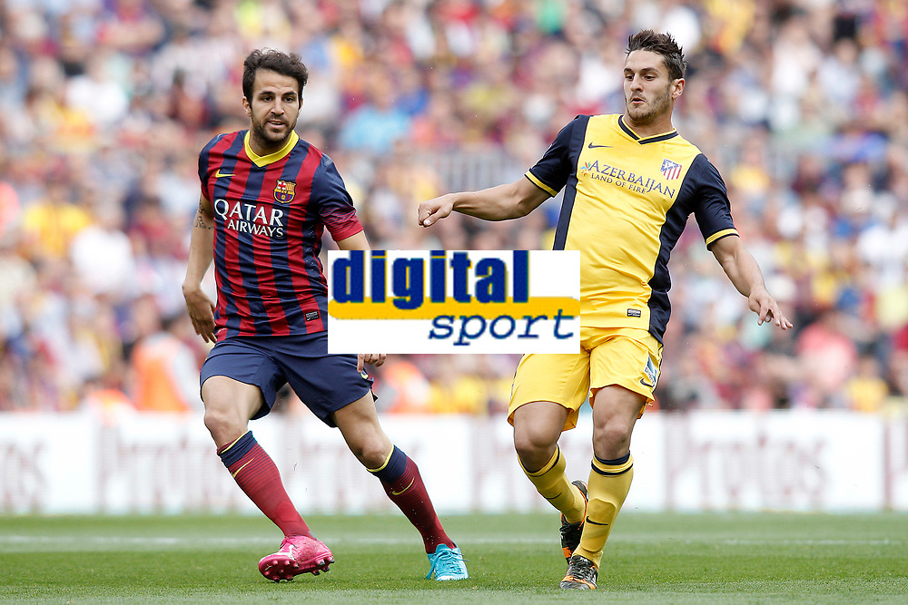 FC Barcelona's Cesc Fabregas (l) and Atletico de Madrid's Koke during La Liga match.May 17,2014. (ALTERPHOTOS/Acero)