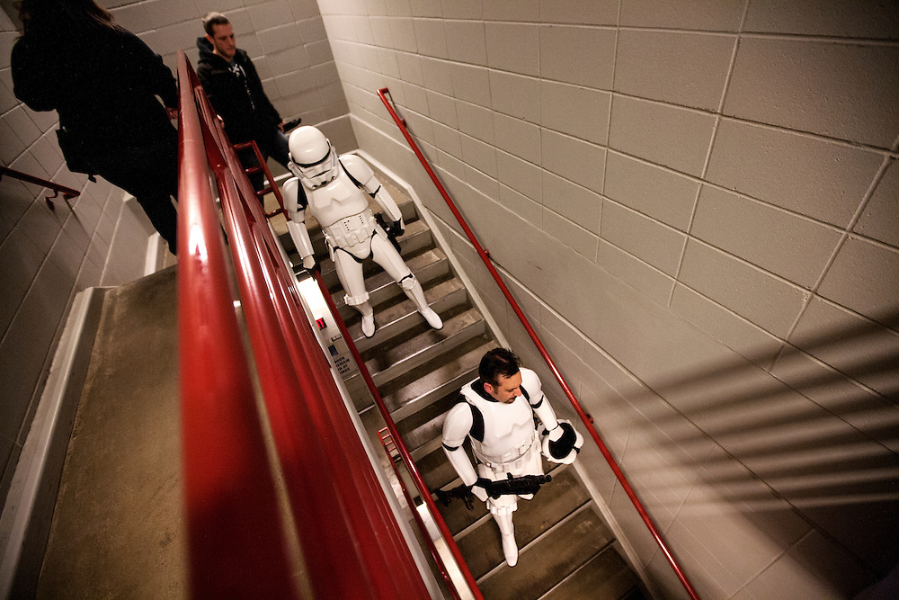 Jeremy Horn, right, of Kenyon and another Storm Trooper walk awkwardly down a back stairway before making an appearance at Star Wars night at the Timberwolves game at Target Center in Minneapolis December 15, 2015. The Trooper armor does not allow much joint flexibility.