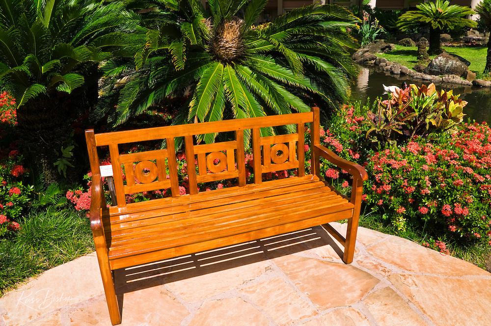 Bench and garden at the Kauai Marriott Resort, Island of Kauai, Hawaii