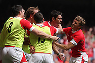 James Hook of Wales (2nd r) is mobbed after he scores his 1st half try. Wales v South Africa,    at Millennium Stadium in Cardiff on Sat 5th June 2010. pic by Andrew Orchard,  Andrew Orchard sports photography,