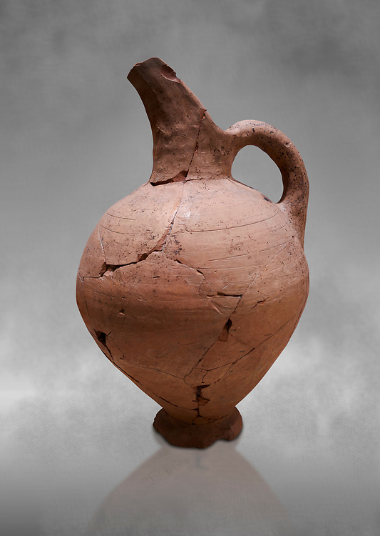 Hittite terra cotta beak spout pitcher . Hittite Period, 1600 - 1200 BC.  Hattusa Boğazkale. Çorum Archaeological Museum, Corum, Turkey. Against a grey bacground. .<br />  <br /> If you prefer to buy from our ALAMY STOCK LIBRARY page at https://www.alamy.com/portfolio/paul-williams-funkystock/hittite-art-antiquities.html  - Hattusa into the LOWER SEARCH WITHIN GALLERY box. Refine search by adding background colour, place,etc<br /> <br /> Visit our HITTITE PHOTO COLLECTIONS for more photos to download or buy as wall art prints https://funkystock.photoshelter.com/gallery-collection/The-Hittites-Art-Artefacts-Antiquities-Historic-Sites-Pictures-Images-of/C0000NUBSMhSc3Oo