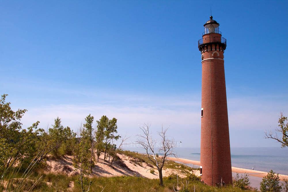 Little Sable Point Light was built in 1874.  It is situated on the eastern coast of Lake Michigan in the Silver Lake State Park. It is constructed of rust brick which has held up well in the elements.  It's tower height is 107ft.  Little Sable is surrounded by sands dunes.  It still has a third order Fresnel lens in operation.