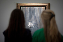 © Licensed to London News Pictures. 14/06/2013. London, UK. Members of Sotheby's staff look at Francis Bacon's 'Head III' (1949, est. GB£5,000,000-7,000,000), the first portrait ever sold by the British artist, at the press view for a Sotheby's auction in London today (14/06/2013). The Contemporary Art Evening Sale takes place on the 26th of June 2013 at Sotheby's New Bond Street premises.  Photo credit: Matt Cetti-Roberts/LNP