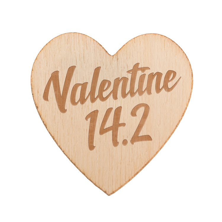 Wooden heart with engraved text 'Valentine 14.2'. Isolated against a white background.