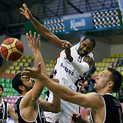 Efes Pilsen's Bootsy THORNTON (C) and Besiktas's Fedor LIKHOLITOV (R) during their Turkish Basketball league Play Off semi final first match Efes Pilsen between Besiktas at the Ayhan Sahenk Arena in Istanbul Turkey on Sunday 09 May 2010. Photo by Aykut AKICI/TURKPIX