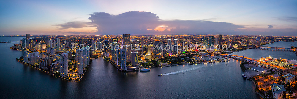 Panoramic aerial wide view of downtown Miami at twilight looking west from Biscayne Bay up the Miami River and featuring Bayfront Park and Brickell Key.  This version is watermarked, contact us to license and clean.
