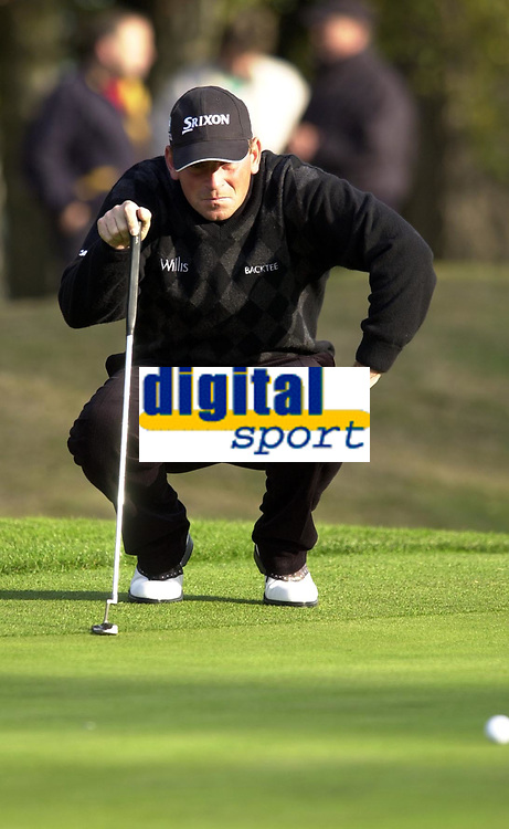 © Peter Spurrier/Sportsbeat Images <br />Tel +441494783165 email images@sbimages.co.uk<br />19/10/2003 - Photo  Peter Spurrier<br />2003 HSBC World Match Play Championship - Wentworth<br />Sunday - Final Day- Ernie Els v Thomas Bjorn:<br />Thomas Bjorn, ckecks the lay of the ball.