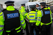 Tensions are high between police and drivers who have been waiting over 48 hours for the Port of Dover to re-open, on the 23rd of December 2020, Dover, Kent, United Kingdom. The French border was closed due to a new strain of COVID-19 all travellers are now waiting to receive a COVID-19 test before they can board a ferry to Calais, France. Dover is the nearest port to France with just 34 kilometres (21 miles) between them. It is one of the busiest ports in the world. As well as freight container ships it is also the main port for P&O and DFDS Seaways ferries.  (photo by Andrew Aitchison / In pictures via Getty Images)