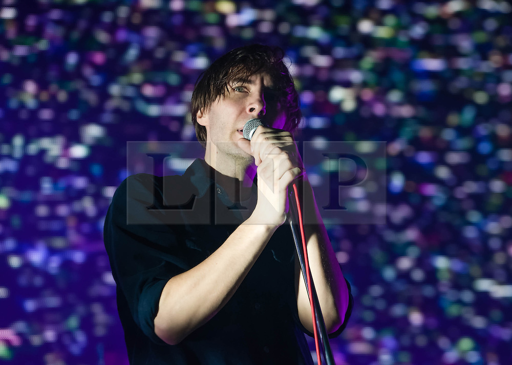 © Licensed to London News Pictures. 12/02/2014. London, UK.   Phoenix performing live at Brixton Academy.   In this picture - Thomas Mars.  Phoenix is a french alternative rock band comprising of members Thomas Mars (vocals), Deck D'Arcy (Bass,Keyboards), Laurent Brancowitz (guitar, keyboards), Christian Mazzalai (guitar).  Photo credit : Richard Isaac/LNP