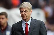 Arsenal manager Arsene Wenger looks on. Barclays Premier league match, Aston Villa v Arsenal at Villa Park in Birmingham on Saturday 20th Sept 2014<br /> pic by Mark Hawkins, Andrew Orchard sports photography.