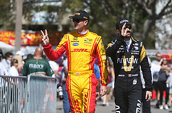 March 10, 2017 - St. Petersburg, Florida, U.S. - DIRK SHADD   |   Times  .IndyCar drivers Ryan Hunter-Reay (left) waves to the crowd along with James Hinchcliffe as they make their way to their cars for the IndyCar practice session on the opening day of the Firestone Grand Prix of St. Petersburg. (Credit Image: © Dirk Shadd/Tampa Bay Times via ZUMA Wire)