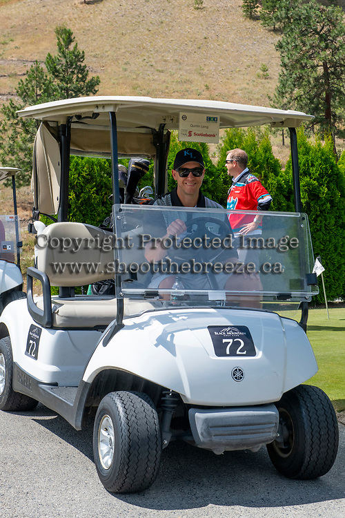 KELOWNA, CANADA - JULY 21: Alumni Curtis Laing drives a golf cart at the Kelowna Rockets Alumni golf tournament at Black Mountain Golf Club in Kelowna, British Columbia, Canada.  (Photo by Marissa Baecker/Shoot the Breeze)  *** Local Caption ***
