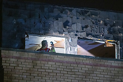 © Licensed to London News Pictures. 14/11/2020. Slough, UK. A fire-fighter take a photograph inside the flat on The Grove in Slough. A high-rise flat in Slough has been gutted by fire. Royal Berkshire Fire and Rescue Servcie and partner agencies attended the fire on Saturday evening after the fire broke out, residents of an adjacent bulding were evacuated as a precaution. Photo credit: Peter Manning/LNP
