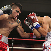 """Jayron Santiago fights Jason Vera during the """"Boxeo Telemundo"""" boxing match at the Kissimmee Civic Center on Friday, March 14, 2014 in Kissimmme, Florida. (Photo/Alex Menendez)"""