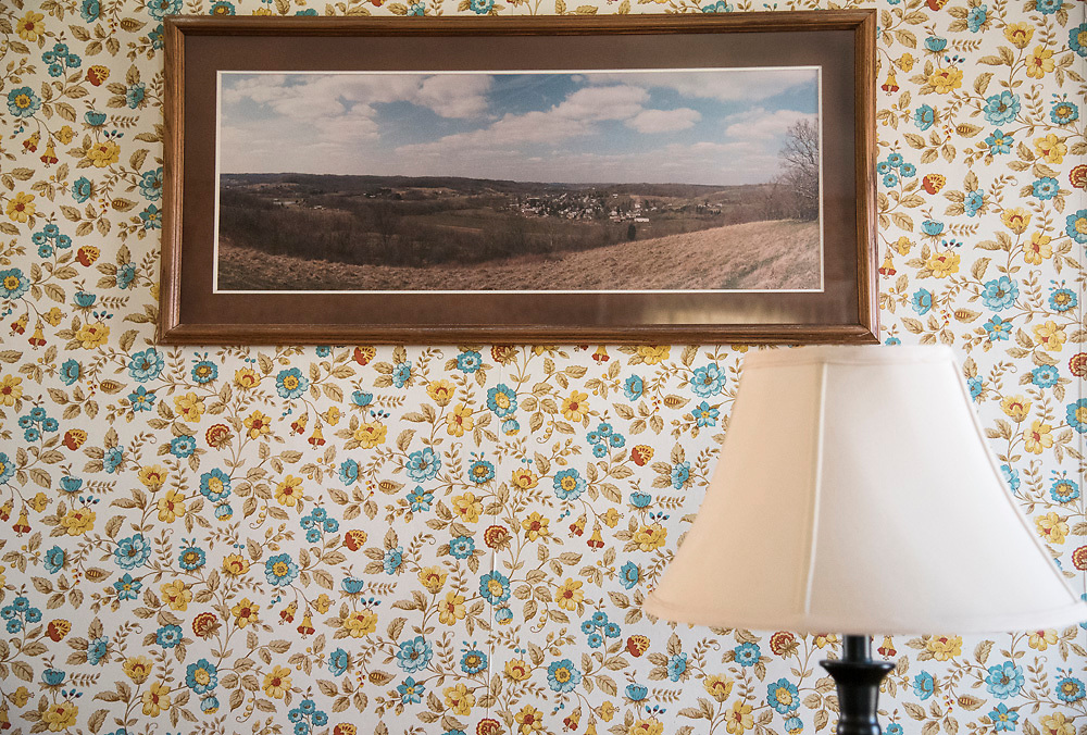A picture overlooking the village of Amesville, hangs inside the Linscott home. Taken the year of the 1998 flood, this picture, which hangs in several Amesville residences, depicts homes and businesses that were bought out and demolished by FEMA after being damaged by flood water later that year.