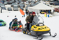 Racers get a ride to the top of the course during the 3rd annual Boat Bash Snow Crash at the Veteran's Memorial Ski Hill in Franklin on Saturday.  (Karen Bobotas/for the Laconia Daily Sun)