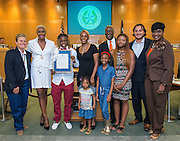 Marmion Dambrino and Trustee Jolanda Jones, Trustee Wanda Adams and Houston ISD Interim Superintendent Ken Huewitt pose for a photograph with Brandolyn Walker during a meeting of the Board of Trustees, June 9, 2016.