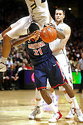 SHOT 1/21/12 5:43:51 PM - Colorado's Sabatino Chen #23 crashes on top of Arizona's Kyle Fogg #21 after a head fake by Fogg during their PAC 12 regular season men's basketball game at the Coors Events Center in Boulder, Co. Colorado won the game 64-63..(Photo by Marc Piscotty / © 2012)