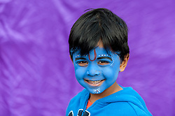 © Licensed to London News Pictures. 05/09/2015. Watford, UK. Pryan, a young boy, aged 4, wears face-paint with gopi dots during his visit to the biggest Janmashtami festival outside of India at the Bhaktivedanta Manor Hare Krishna Temple in Watford, Hertfordshire.  The event celebrates the birth of Lord Krishna and the festival  includes music, dance, food, dramas and more. Photo credit : Stephen Chung/LNP