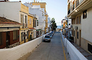 Flash flood risk cars parked in concrete lined river channel raised above street level La Cala del Moral, Malaga, Spain
