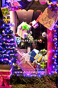 Christmas window display at Drake Algar florist in St John's Wood High Street, London