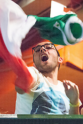 © Licensed to London News Pictures . 14/06/2014 .  Manchester , UK . Italy fans celebrate going 1 ahead . Football fans watch the England vs Italy World Cup tie at Walkabout in Manchester City Centre this evening (Saturday 14th June 2014) as England play Italy in their first match of the 2014 World Cup , in Brazil . Photo credit : Joel Goodman/LNP