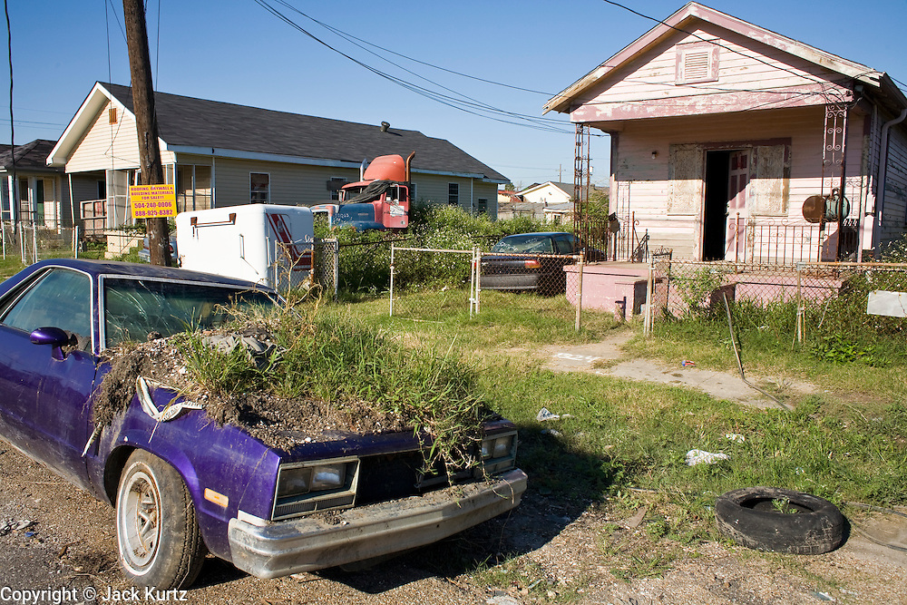 20 SEPTEMBER 2006 - NEW ORLEANS, LOUISIANA:  Grass growing out of the hood of an abandoned car in the Lower 9th Ward of New Orleans, LA. The neighborhood was abandoned after flooding from nearby canals after Hurricane Katrina inundated this part of the city. Photo by Jack Kurtz / ZUMA Press