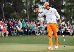 April 8, 2018 - Augusta, GA, USA - Rickie Fowler acknowledges the crowd after his putt on 18 during the final round of the Masters at Augusta National Golf Club on Sunday, April 8, 2018, in Augusta, Ga. (Credit Image: © Jason Getz/TNS via ZUMA Wire)