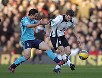 Photo: Olly Greenwood.<br />Fulham v Tottenham Hotspur. The Barclays Premiership. 20/01/2007. Tottenham's Steed Malbranque and Fulham's Moritz Volz