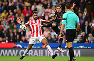 Maxim Choupo of Stoke city (l) battles for the ball with Hector Bellerin of Arsenal. Premier league match, Stoke City v Arsenal at the Bet365 Stadium in Stoke on Trent, Staffs on Saturday 19th August 2017.<br /> pic by Bradley Collyer, Andrew Orchard sports photography.