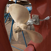 Gloucester, MA USA, April 14, 2015. New propeller on an old wooden boat at the Gloucester Marine Railways in Rocky Neck