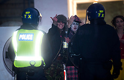 © Licensed to London News Pictures. 01/11/2015. London, UK. Two party goers being confronted by police. The scene where Riot police clashed with party goers at the site of an illegal halloween rave in London where it has been reported that a petrol bomb was thrown. Photo credit: Ben Cawthra/LNP