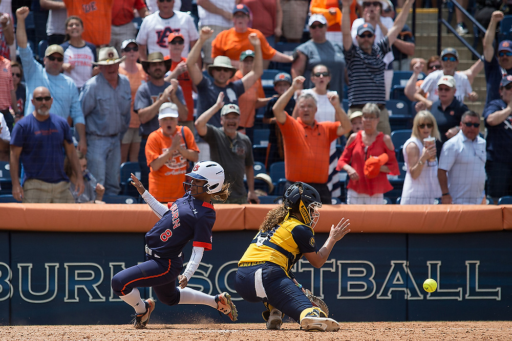 Auburn pinch runner Brittany Maresette (8) slides past Cal catcher Annie Aldreteto (13) to score the game-winning run off of Alyssa Rivera's RBI-single in the bottom of the ninth inning. <br /> Cal Golden Bears vs. No. 7 Auburn Tigers in the NCAA Tournament Regionals at Jane B. Moore Field in Auburn, Ala. on Saturday, May 20, 2017.<br /> Zach Bland Photo