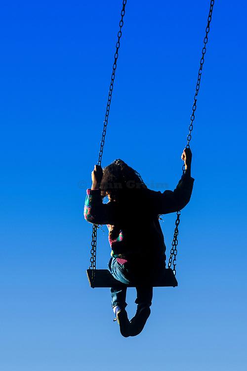 Girl on swing.