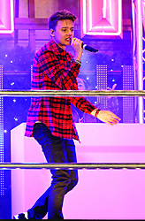 Conor Maynard performs as Christmas lights for the famous London High Street are turned on at event hosted by Selfridges on Oxford Street, London, United Kingdom. Tuesday, 12th November 2013. Picture by Nils Jorgensen / i-Images