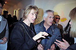 Leading make-up artist BARBARA DALY and her husband LAURENCE TARLO at a private view entitled 'No Love Lost' by artists Daisy de Villeneuve and Natasha Law held at Eleven, 11 Eccleston Street, London SW1 on 31st March 2009.