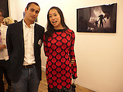 "ALEX DELLAL; YI ZHOU, Video artist Yi Zhou  first solo show ""I am your Simulacrum"".Exhibition opening at 20 Hoxton Square Projects. Hoxton Sq. London. 1 September 2010.  -DO NOT ARCHIVE-© Copyright Photograph by Dafydd Jones. 248 Clapham Rd. London SW9 0PZ. Tel 0207 820 0771. www.dafjones.com."