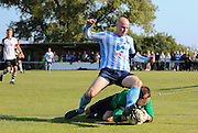 Worthing United Sam Blundell battles with the East Preston Goalkeeper Darren Ford before the FA Vase 1st Qualifying Round match between Worthing United and East Preston FC at the Robert Eaton Memorial Ground, Worthing, United Kingdom on 6 September 2015. Photo by Phil Duncan.